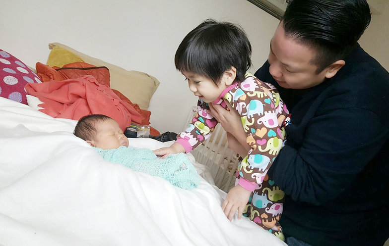 Eva working with little boy and newborn baby