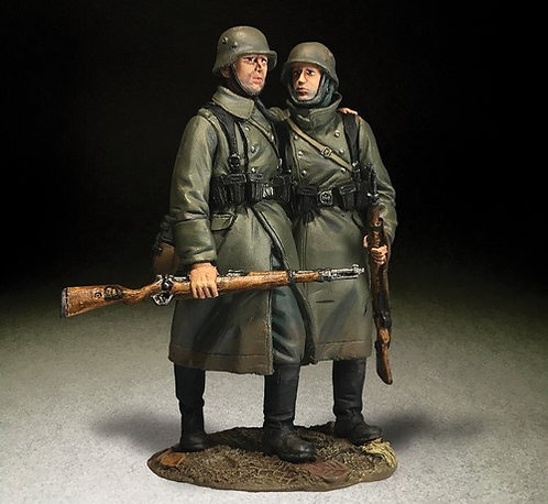 25060 - German Helping Wounded Comrade in Greatcoat