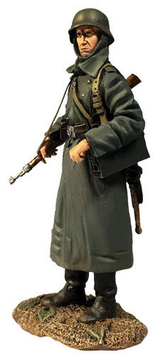 25077 - German Volksgrenadier Standing with Ammo Can In Greatcoat