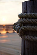 Post with rope at sunrise