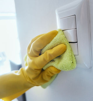 person-cleaning-and-disinfecting-electri