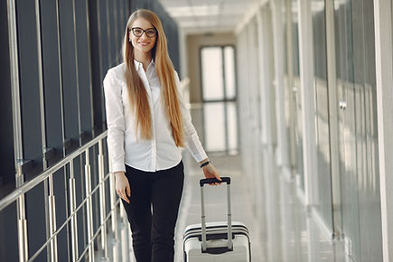 woman-with-suitcase-at-the-airport-CR4XJ