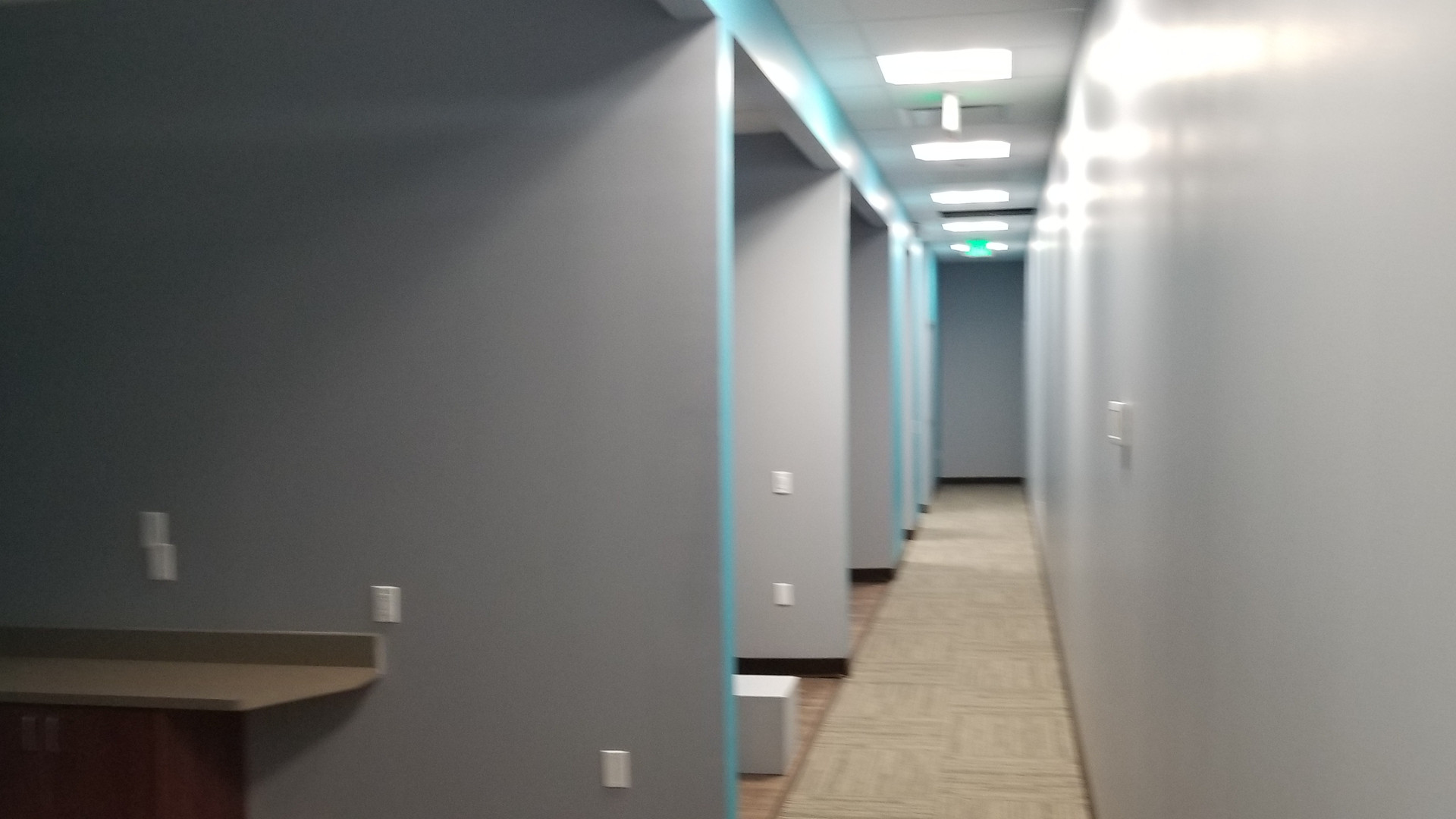 Grey Hallway with Blue Accent - Buildout Pros