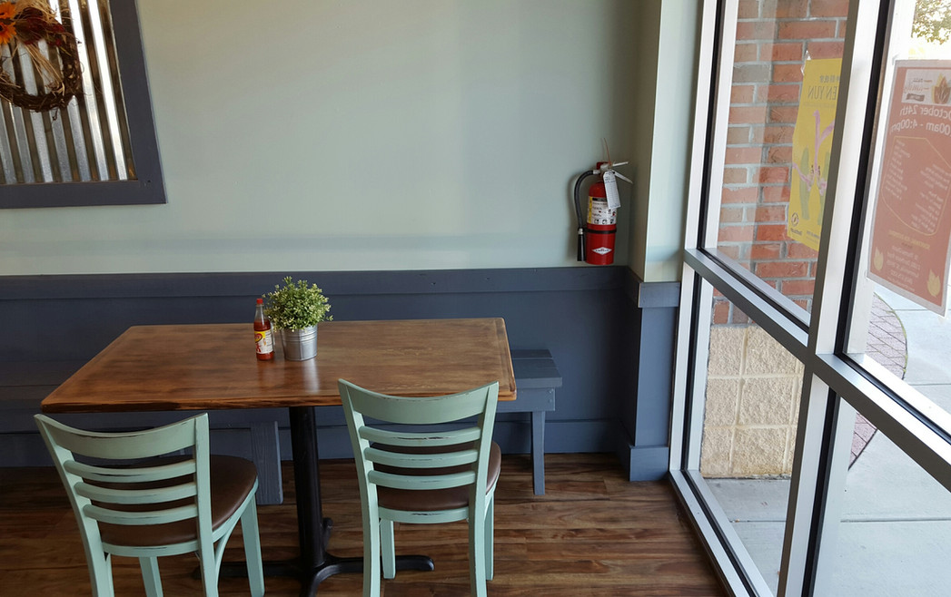Table with Chairs and Bench by Window - Buildingout Pro
