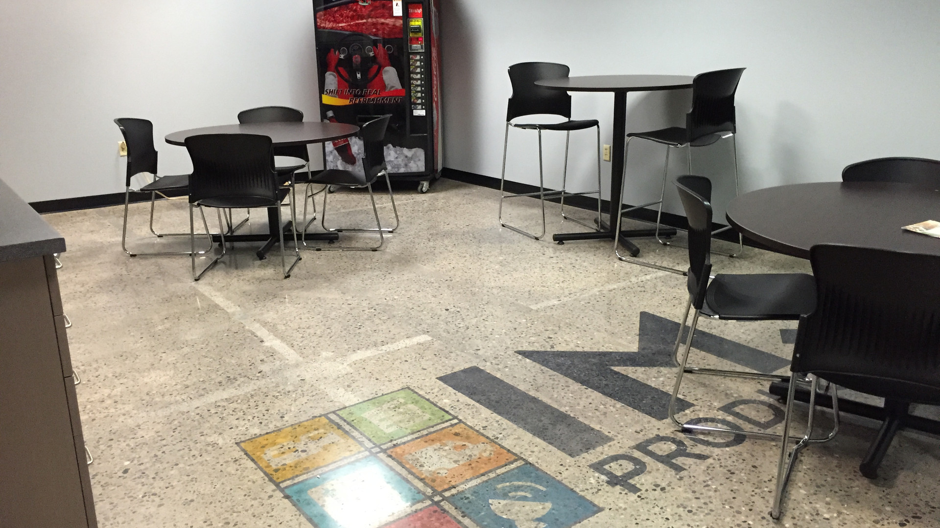 Logo on Floor and Sitting Area - Buildout Pros