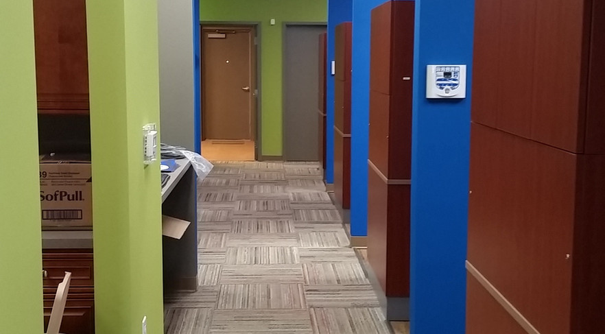 Rennovated dentist office Hallway - Buildout Pros