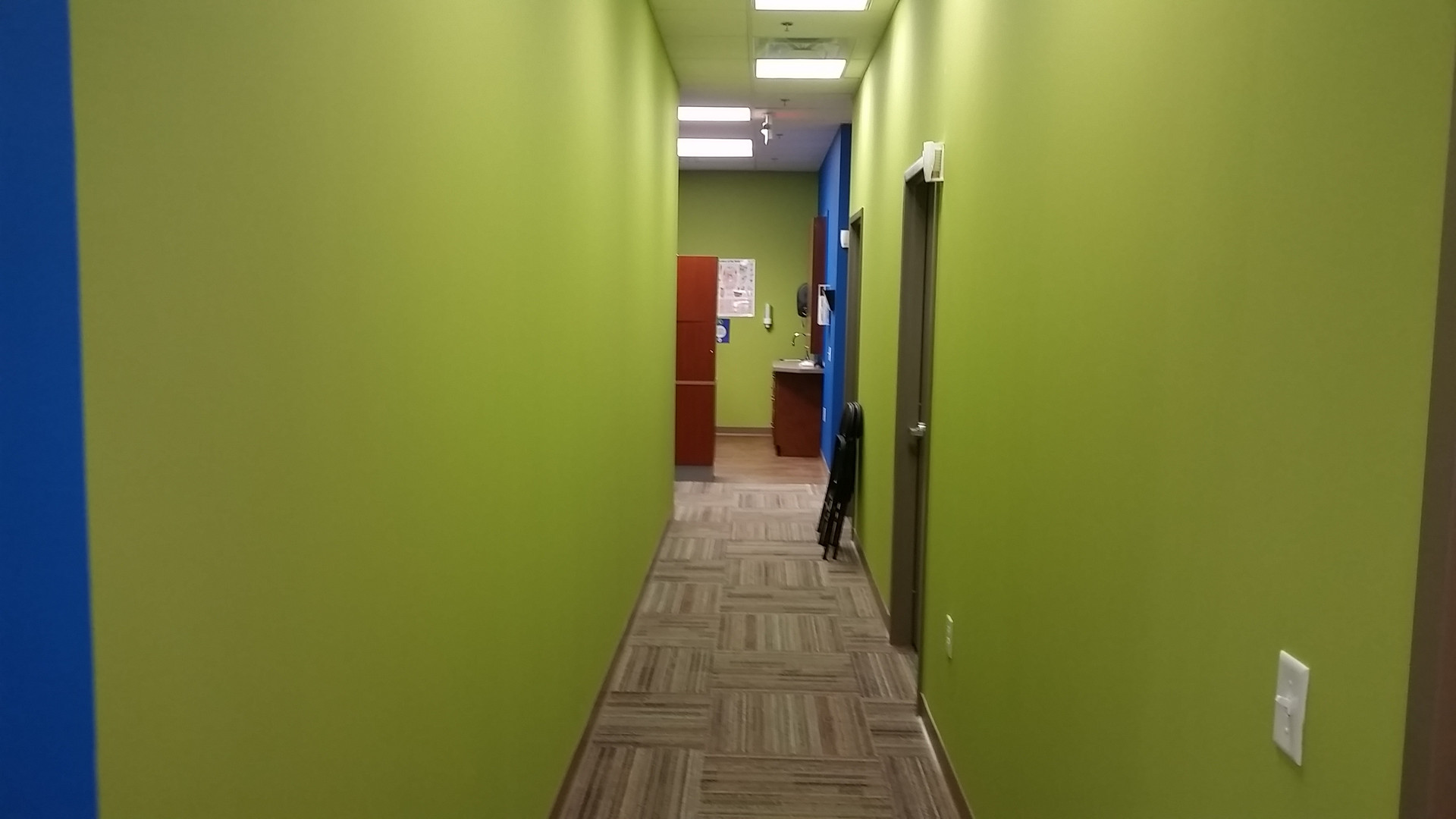 Green Wall Hallway - Buildout Pros
