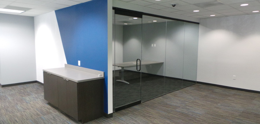 Office with Glass Doors for Viewing - Buildout Pros