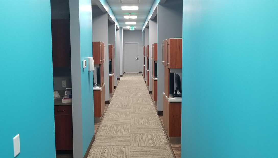 Bright Blue Hallway - Buildout Pros