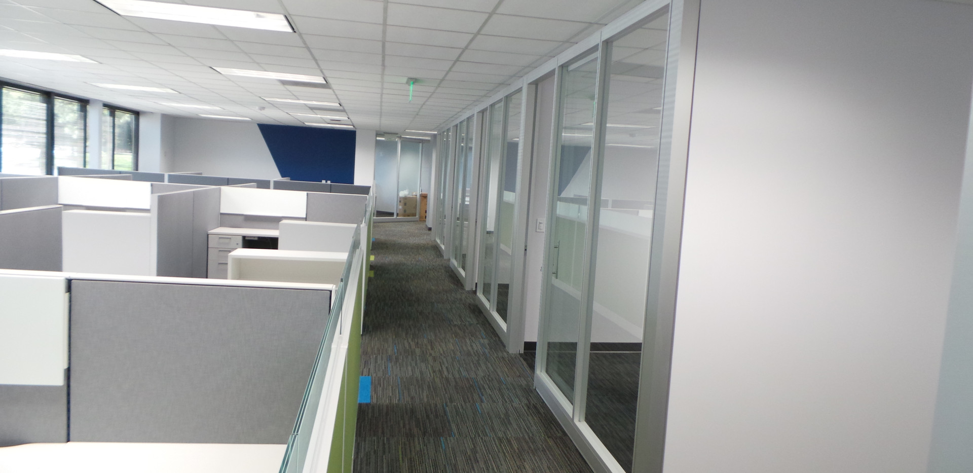 Hallway View of Desks and Offices - Buildout Pros