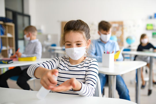 Small girl with face mask at school afte
