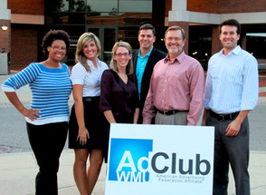 AdClub e-board with speaker in front of