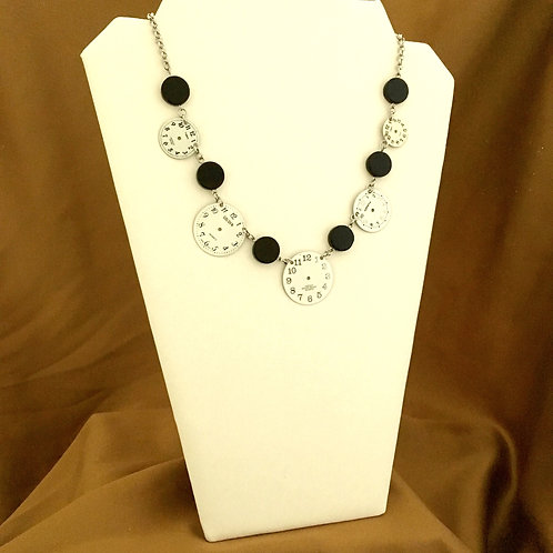 Black and white watch face necklace.