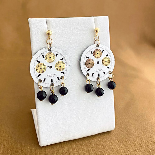 Gold detailed watch face earrings