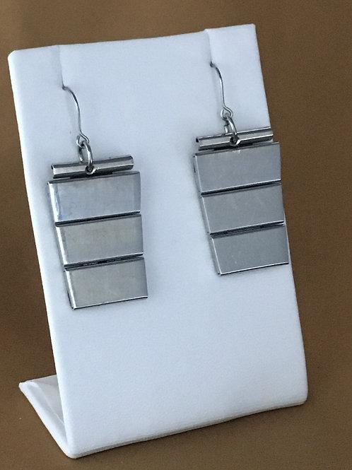 Flat panel watchband earrings.