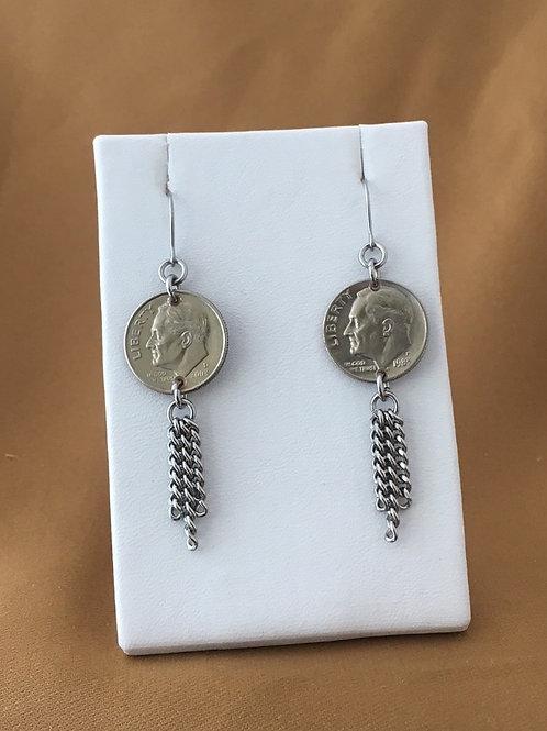 Extended fringe dime earrings.