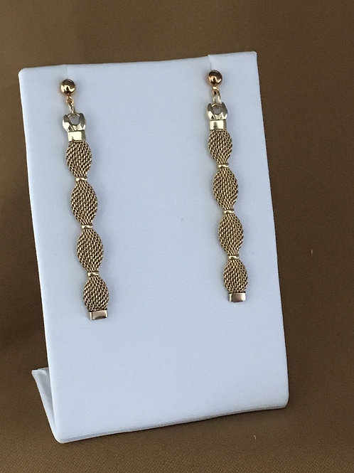 Cinched gold mesh watchband earrings.