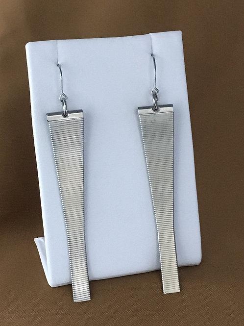 Elongated matte watchband earrings.