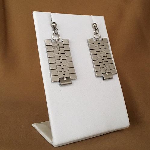 Sleek matte link watchband earrings.