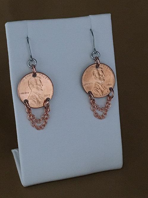 Double swag penny earrings.