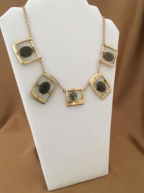 Gold buckle necklace with agate accents.