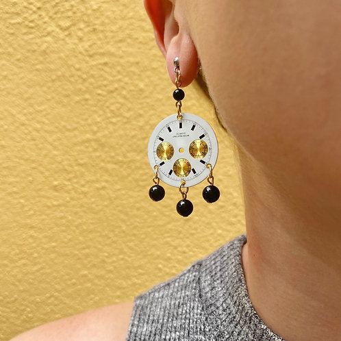 White and gold watch face earrings