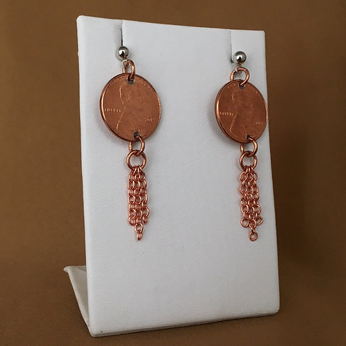 Slender fringe penny earrings.