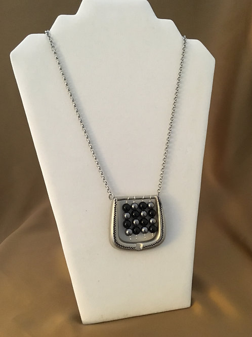 Etched buckle necklace with hanging beads.