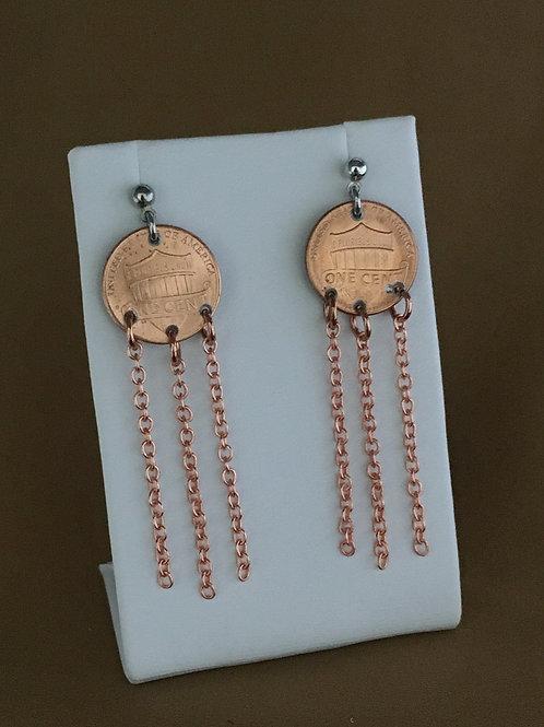 Extended fringe penny earrings.