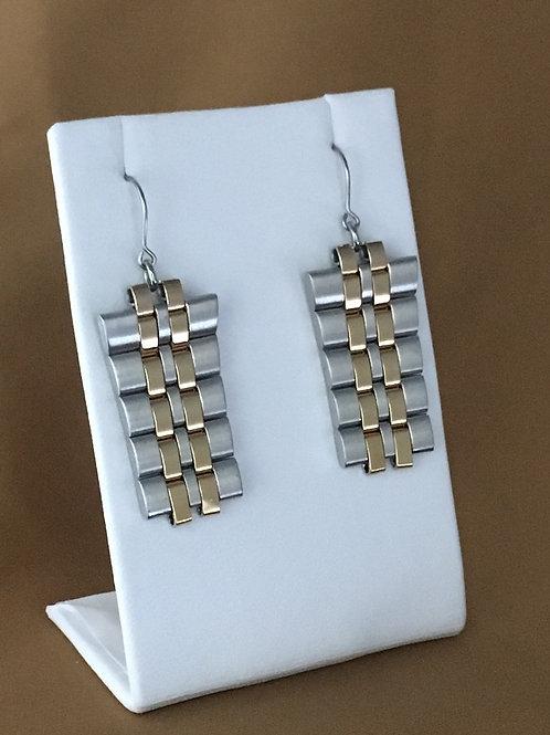 Dual finish watchband earrings.