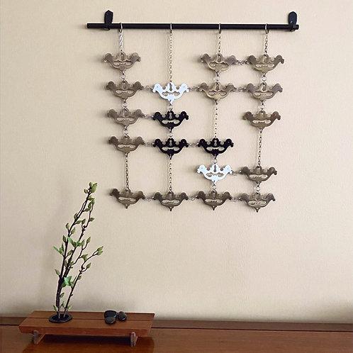 Brass escutcheon wall hanging