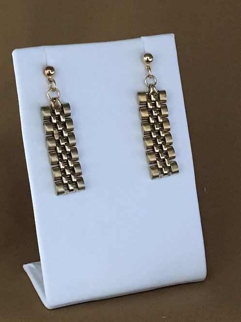 Gold link watchband earrings.