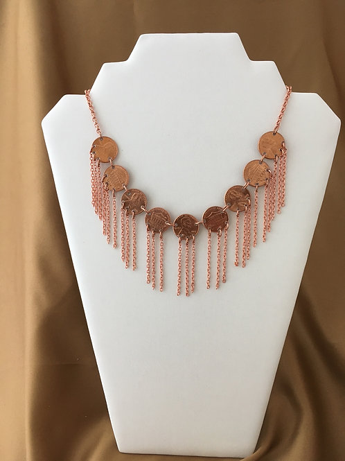 Fringed penny necklace.
