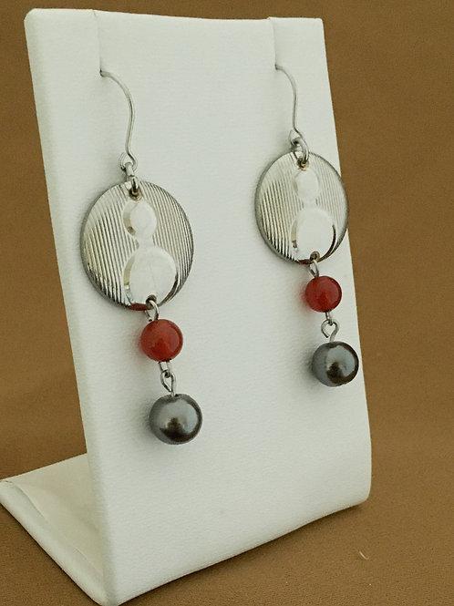 Double circle cufflink earrings.