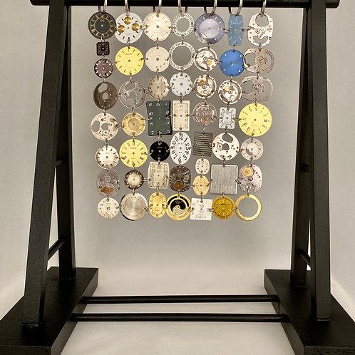 Vintage watch parts hanging
