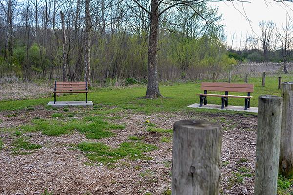 Benches located at the entrance the Ohio Nature Preserve Kinnikinnick Fen Nature Preserve