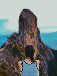 Girl Looking Over Rocky Landscape