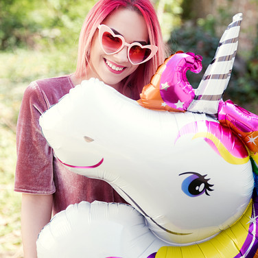 Young woman holding unicorn balloon.jpg