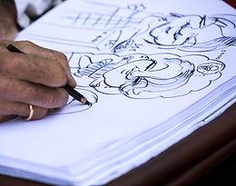 Caricature artist drawing.jpg