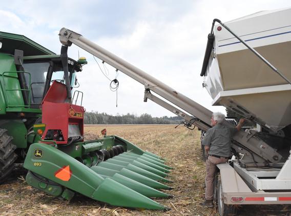 Refilling cover crop seeder.jpg