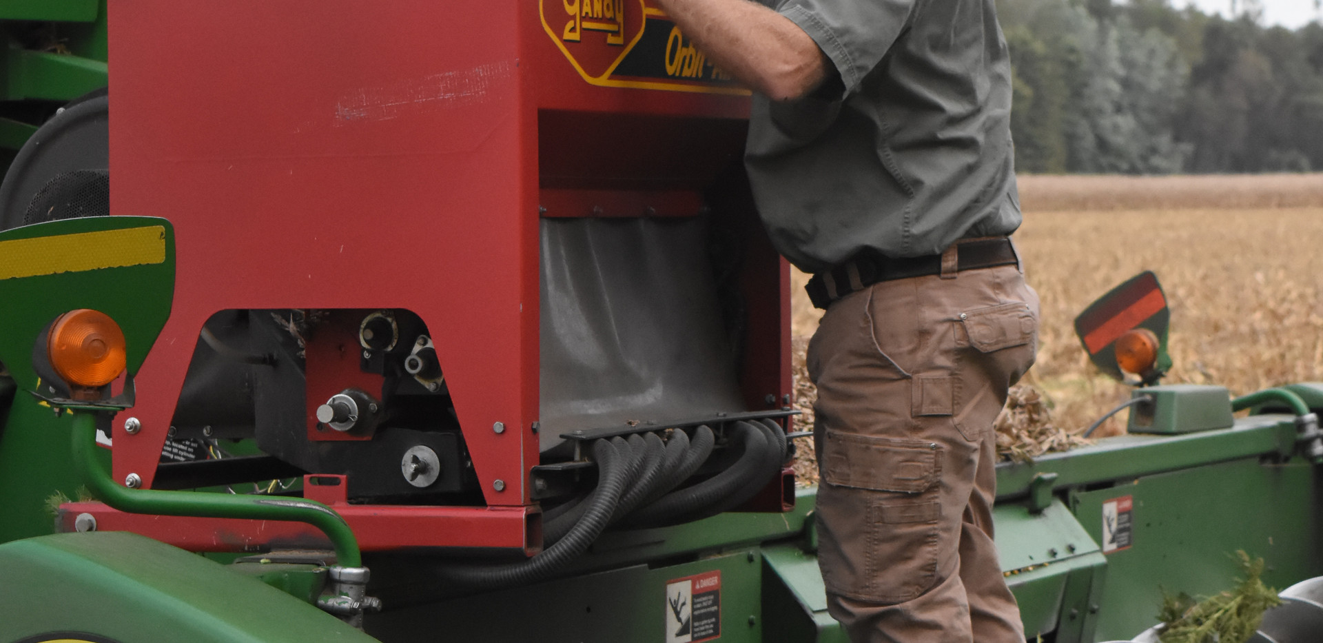 Inspecting a cover crop seeder.jpg