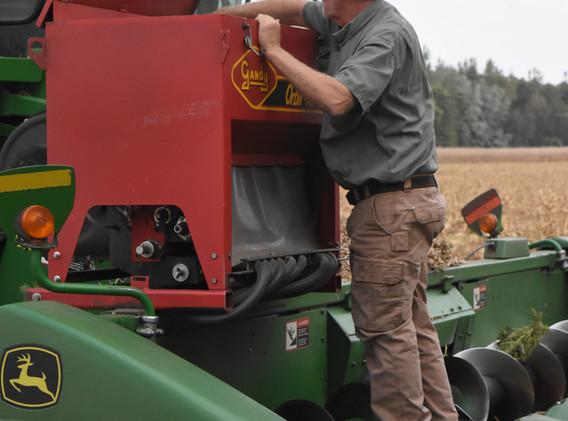 Inspecting a cover crop seeder.jpg