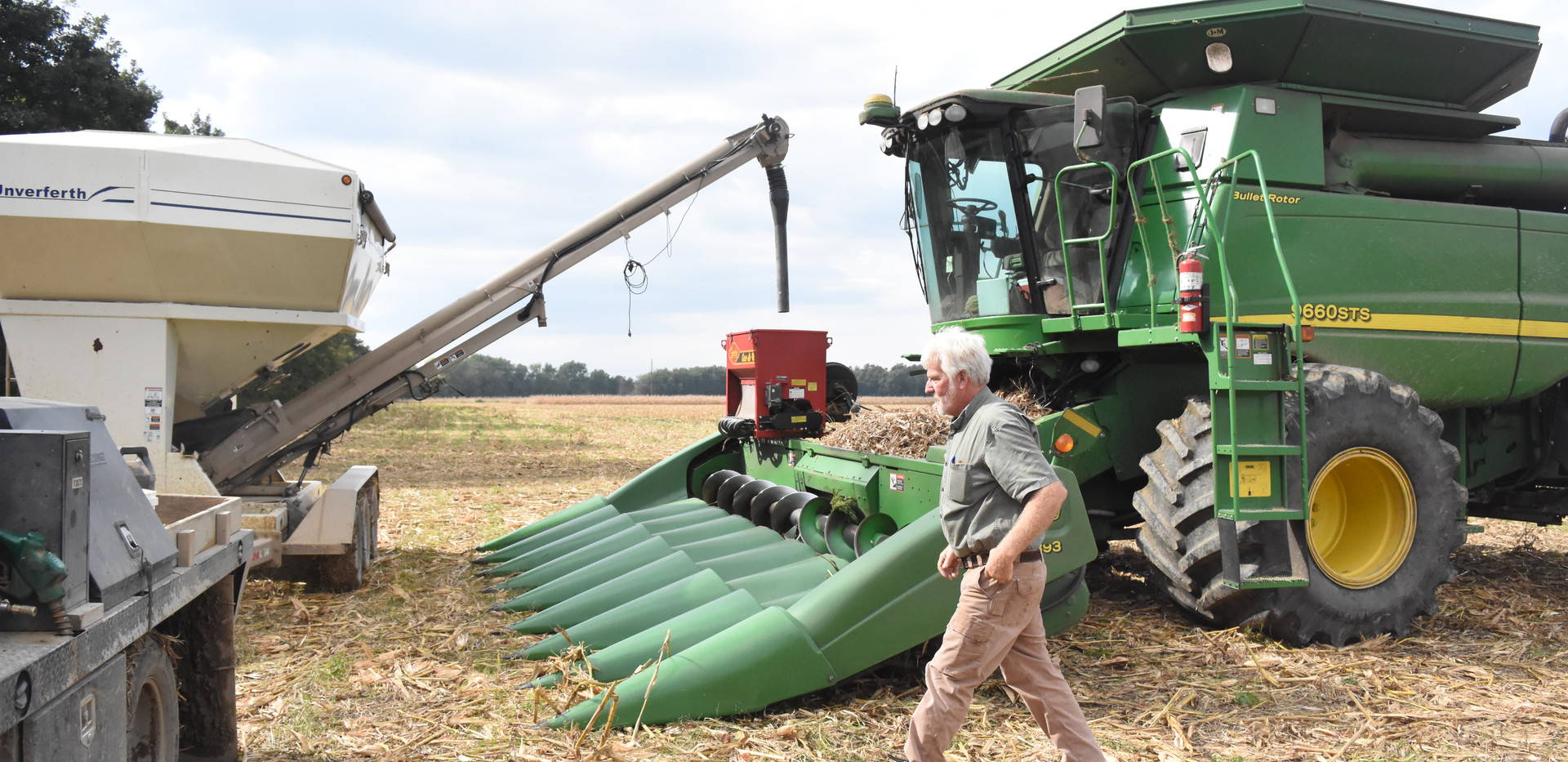 Refilling cover crop seeder on combine,