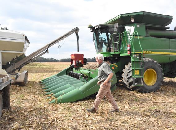 Refilling cover crop seeder on combine,