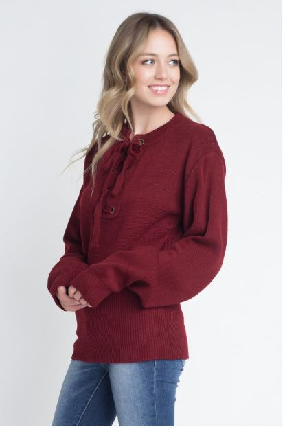 2b4fbb61c9 This trendy sweater features a criss cross lace up detail on the neckline