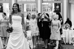 Bride tossing the bouquet of flowers at wedding reception