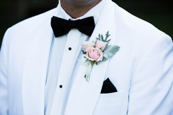 White wedding tuxedo with pink flowers: wedding detail