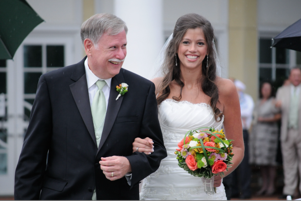 Bride and Father of the bride walking down the isle. Beautiful wedding photography