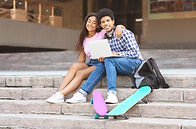 couple-of-black-teens-sitting-on-stairs-
