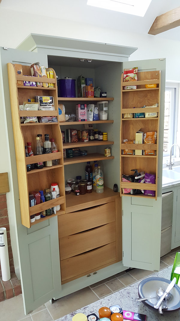 Lader cupboard with oak shelves and drawers made in a shaker style